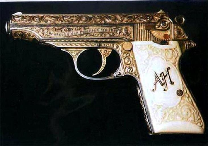 Позолоченный пистолет