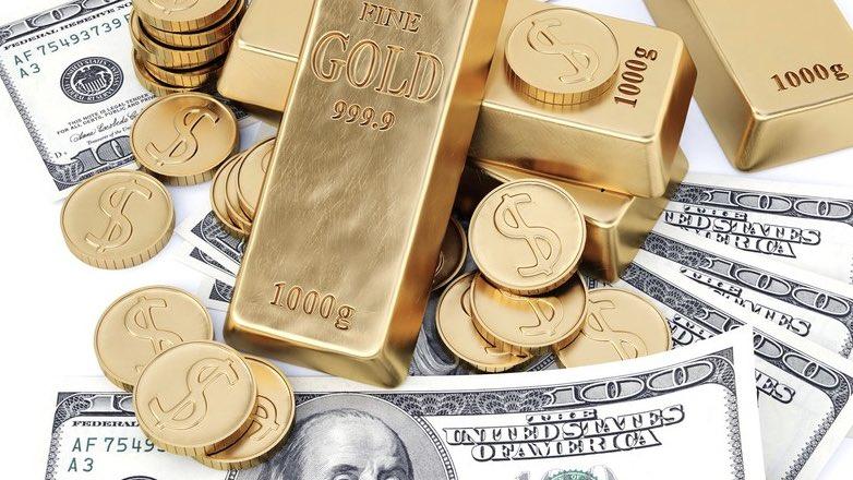 Золотые слитки, монеты и доллары