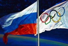 Российский и олимпийский флаг